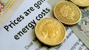 An energy bill letter and money.