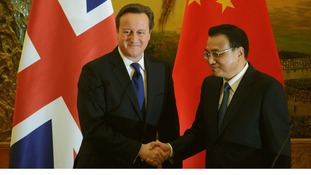 David Cameron (L) and China's Premier Li Keqiang shake hands following a signing ceremony at the Great Hall of the People in Beijing.