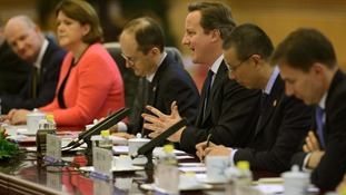 David Cameron and China's Premier Li Keqiang (unseen) attend a summit meeting at the Great Hall of the People in Beijing.