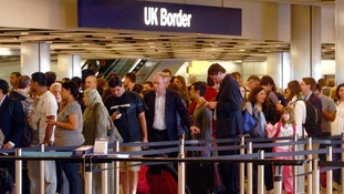 Passenger wait at immigration queues at Heathrow