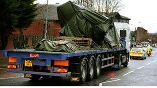 The wreckage of the police three-tonne Eurocopter is taken away