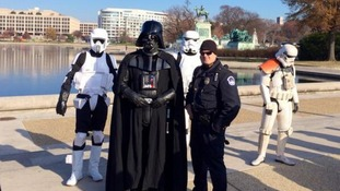 Darth Vader mingling with local law enforcement in Washington, DC