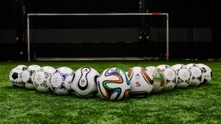 The brazuca sits in front of precious match balls.