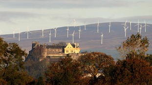 Stirling Castle with the Braes of Doune wind farm behind it