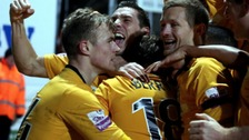 Luke Berry is smothered by his team-mates after scoring the winner.