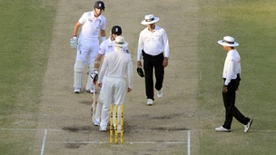 England's James Anderson (second left) exchanges words with Australia's Michael Clark