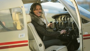 Loose Woman Carol Vorderman pictured in the pilot's seat of a light aircraft.
