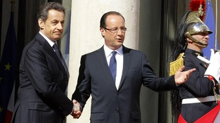 Outgoing president Nicolas Sarkozy with Francois Hollande.