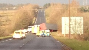 The lorry on its side on the A801 in Scotland