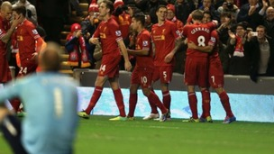 Luis Suarez celebrates one of his four goals.