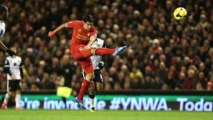 Suarez opens the scoring with an audacious long-range effort.