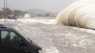 Waves crash on loan in Porth Eirias in Wales