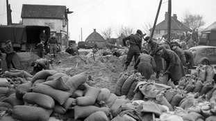 Servicemen and civilian workers repair sea defences at Canvey Island, Essex