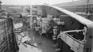 British frigate HMS Berkeley Castle lies on her side in Sheerness naval dockyard after she had capsized by the floods