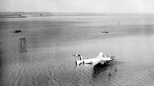 A plane bearing Royal Air Force markings surrounded by the flood waters in the Thames Estuary