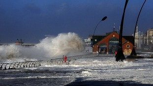Waves crash on the Blackpool Main Promenade during high tide and a tidal surge.