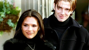 The then-Victoria Adams and David Beckham pose for the cameras after announcing their engagement in January 1998.