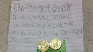 The letter sent to John Lewis from Faith including two, one pound coins.
