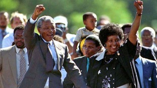 After almost 27 years in jail, Nelson Mandela walks free from Victor Verster prison near Cape Town on 11 February 1990.