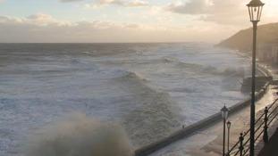 The stormy sea engulfs the coast.