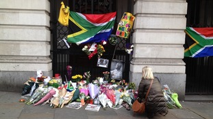 People have been leaving tributes in honour of Nelson Mandela outside South Africa house in London.