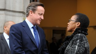 David Cameron speaks to Acting High Commissioner Bongiwe Qwabe as he leaves South Africa House.
