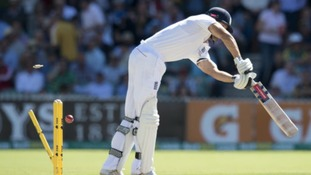 Alastair Cook is bowled by Mitchell Johnson.