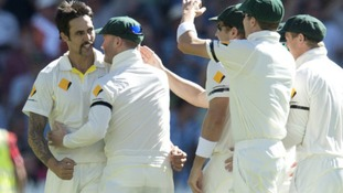Mitchell Johnson celebrates taking Alastair Cook's wicket.