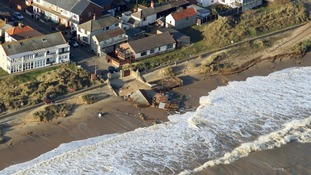 A seafront café suffered at the hands of the tide last night.