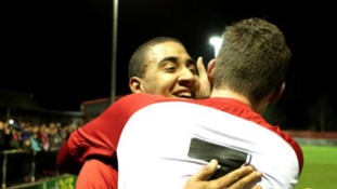 Glenn Walker and Elliot Sandy embrace after knocking out Gillingham.