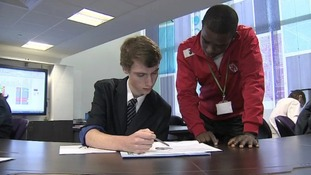 Eddie Odhiambo watches over a pupil's work.