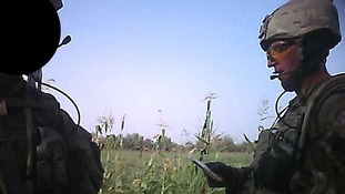 Sergeant Alexander Blackman (right) was filmed on a fellow Royal Marine's headcam.