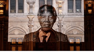 The face of Nelson Mandela is projected on the facade of Paris City Hall.