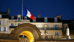 The French flag flies at at half mast in the courtyard of the Elysee Palace in Paris.