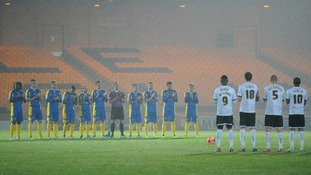 Port Vale and Salisbury City hold a minutes applause for Nelson Mandela.