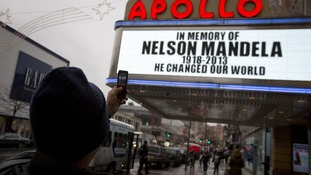 The Apollo Theatre displays a memoriam to the late Nelson Mandela in the Harlem area of New York.
