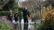 Clear up begins after tidal surges flood UK