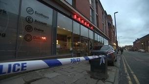 Akbar's restaurant with a police cordon in place