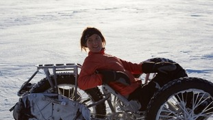 Maria Leijerstam on bike in snow