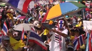 A protester waves the Thai flag