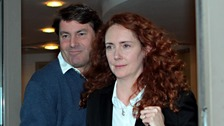 Charlie Brooks and his wife Rebekah leave their lawyers offices in London
