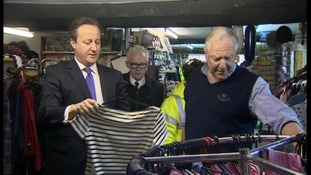 David Cameron views tidal surge damage