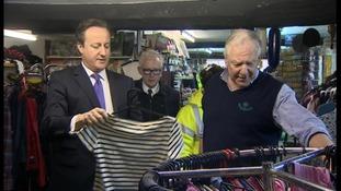 David Cameron views tidal surge damage