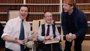 Chancellor George Osborne meets actor Rupert Grint and 9-year-old Callum Wilson from Falkirk.