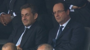 French President Francois Hollande (R) and former president Nicolas Sarkozy