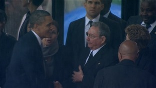 President Obama shakes hands with Raul Castro