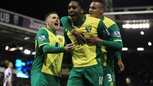 Josh Murphy, seen here embracing Leroy Fer after Saturday's win over West Brom, has now broken into the Canaries first team.