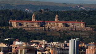 The Union building is seen behind the city of Pretoria
