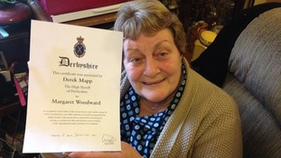 Margaret Woodward with her certificate