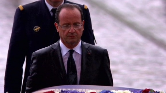 Francois Hollande in the rain in Paris